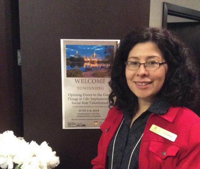 Cecilia and the welcome to Winnipeg poster.
